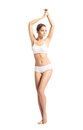 A fit woman in white sporty lingerie young and beautiful girl isolated on Royalty Free Stock Photography