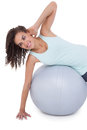 Fit woman wokring out on exercise ball Royalty Free Stock Photo