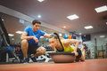 Fit woman working out with trainer women at the gym Royalty Free Stock Images