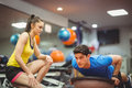 Fit woman working out with trainer women at the gym Stock Image