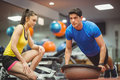 Fit woman working out with trainer women at the gym Royalty Free Stock Photography