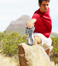 Fit young athlete stretching his legs Royalty Free Stock Photo