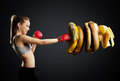 Fit, young, energetic woman boxing unhealthy food Royalty Free Stock Photo