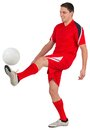 Fit young football player kicking on white background Royalty Free Stock Photos