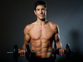 Fit young male with great healthy body and dumbells Stock Photos