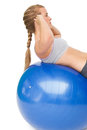 Fit young woman doing crunches on exercise ball side view of a over white background Stock Images
