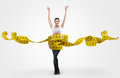 Fit young woman with a large measuring tape on gray background Stock Photos