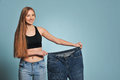 Fit young woman in loose jeans Royalty Free Stock Photo