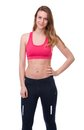 Fit young woman portrait of a in gym clothes posing on isolated white background Stock Photos