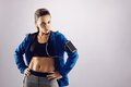 Fit young woman posing confidently in sportswear portrait of attractive caucasian fitness wearing looking at camera while standing Royalty Free Stock Image