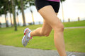 Fitness asian woman legs running healthy lifestyle at tropical park Stock Photos