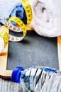 Fitness background with water bottle and towels Royalty Free Stock Photo