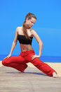 Fitness the beach young beautiful woman doing exercises at Royalty Free Stock Photos