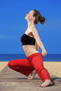 Fitness the beach young beautiful woman doing exercises at Stock Photography
