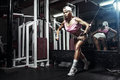 Fitness blonde woman exercising in gym Royalty Free Stock Photo