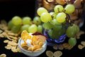 Fitness breakfast with grapes,corn flakes, yougurt and dried sliced apple Royalty Free Stock Photo