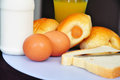 Fitness breakfast set european with bun bread eggs milk and juice Stock Photography