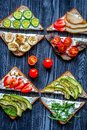 Fitness breskfast with homemade sandwiches dark table background top view