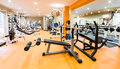 Fitness club interior view of a gym with equipment Royalty Free Stock Photos