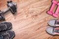 Fitness equipment on wood floor background.