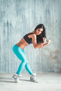 Fitness exercise young beautiful woman posing on a studio background Royalty Free Stock Images