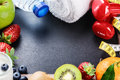 Fitness frame with dumbbells towel and fresh fruits copy space Stock Image