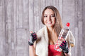 Fitness girl with bottle of water and towel Stock Images