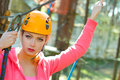 Fitness girl climber beautiful woman in a special outfit climbing the trees Stock Image