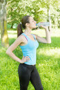 Fitness girl drinking water refreshment outdoor Royalty Free Stock Photo