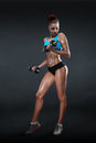 Fitness girl with dumbbells on a dark background isolated clipping path Royalty Free Stock Photos
