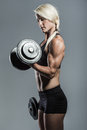 Fitness girl with dumbells a young and very fit woman training Stock Photo
