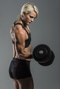 Fitness girl with dumbells a young and very fit woman training Royalty Free Stock Photo