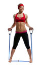 Fitness girl with expander Royalty Free Stock Photos