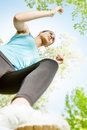 Fitness girl jogging in the park view from below Stock Image