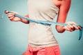 Fitness girl measuring her waistline Royalty Free Stock Photo