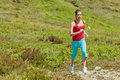 Fitness girl running in mountains Stock Photo