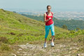 Fitness girl running in mountains Stock Image