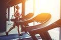 Fitness girl running on treadmill Royalty Free Stock Photo