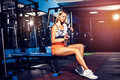 Fitness girl with shaker posing in the gym Royalty Free Stock Photo