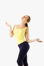 Fitness girl spreads his arms out to the side and smiling. Royalty Free Stock Photo