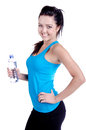 Fitness girl studio shot of a isolated on white holding a bottle of water in her hand and smiling Stock Photos