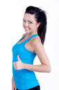 Fitness girl studio shot of a isolated on white holding a bottle of water in her hand and smiling Stock Images