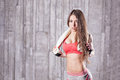Fitness girl with towel in gym Royalty Free Stock Photography