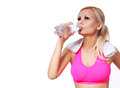Fitness girl with water bottle and towel beautiful blonde young woman isolated on white background Stock Photography