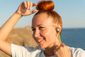 Fitness girl with wireless headphones Royalty Free Stock Photo