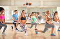 Fitness group in gym doing aerobic exercises Royalty Free Stock Photo