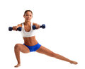 Fitness instructor doing split with dumbbells Royalty Free Stock Photography