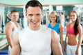 Fitness instructor with gym people young Stock Photo