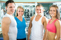 Fitness instructor with gym people young Stock Photos