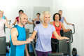 Fitness instructor leading gym people exercise Stock Photography